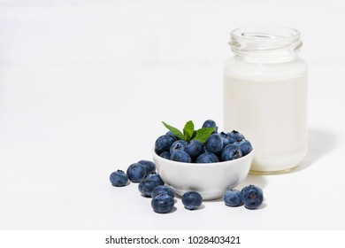 fresh blueberries and a bottle of milk, horizontal
