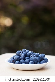 Fresh Blueberries in a bowl on a blurred background