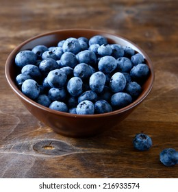Fresh blueberries in a bowl of wooden boards, healthy food