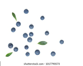 Fresh Blueberries with leaves isolated on white background. Flat lay, top view