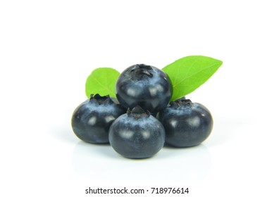 Fresh blueberries with leaves isolated on white background.