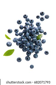 Fresh Blueberries With Leaves on White Background. Scattered blueberries over white background.