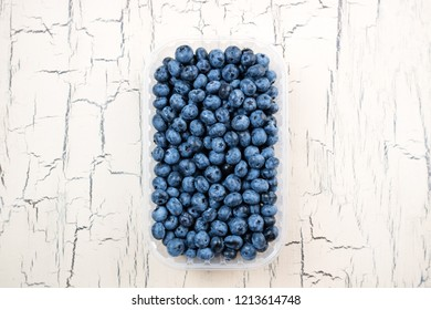 Fresh blueberries on light background. Bilberry on wooden table. Concept for healthy eating dieting food and nutrition