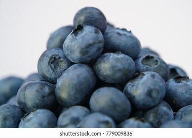 Fresh blueberries on white background close up