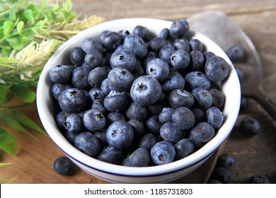 Fresh Blueberries on Wood Background