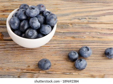 Fresh blueberries on a wooden background. Selective focus