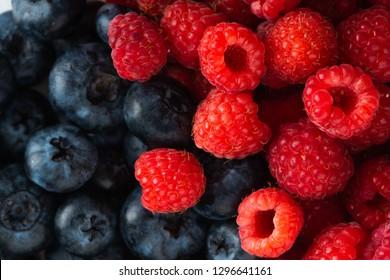 Fresh blueberries and raspberries, close up