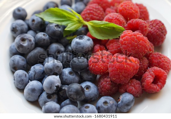 fresh blueberries and raspberries close-up in natural light