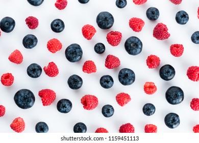 Fresh blueberries and raspberries, top view