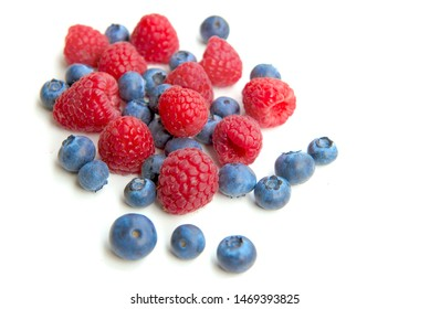 Fresh blueberries, raspberry isolated on white background.