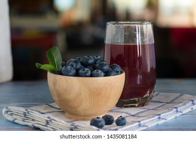 Fresh blueberry and berry juice in glasses 