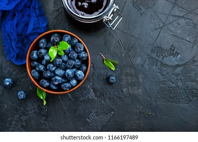 fresh blueberry in bowl and on a table