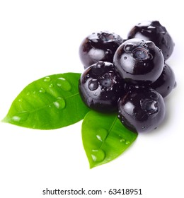 Fresh blueberry with green leaf isolated on white background