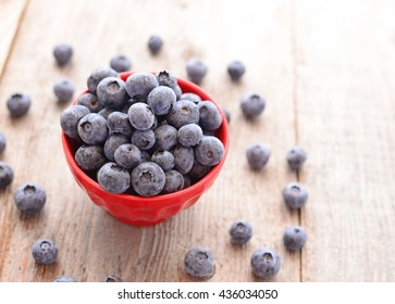 Fresh blueberry on wooden background