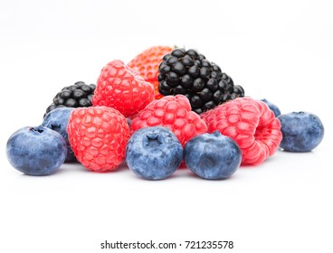Fresh blueberry raspberry and blackberry closeup on white background