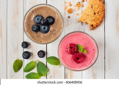 Fresh blueberry and raspberry smoothie with cookie and peppermint