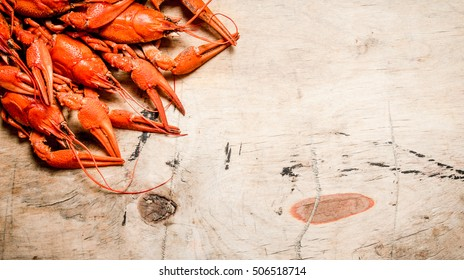 Fresh boiled crawfish. On a Wooden background.