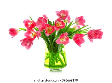Fresh bouquet of tulips in a vase isolated on white