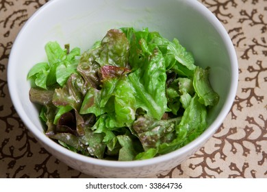 Fresh bowl of green salad with creamy white french dressing