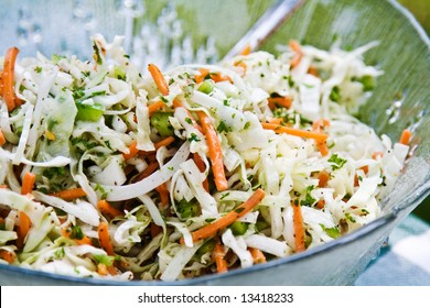 A fresh bowl of homemade coleslaw with dressing.