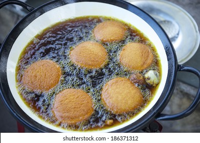 Fresh Brazilian acaraje cuisine cooking in dark boiling dende palm oil
