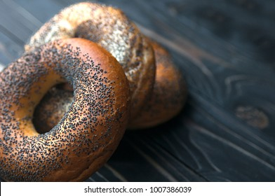 Fresh bread bagel with poppy seed on sackcloth. Russian traditional bakery product. or bakery pastry banner, ad, poster.