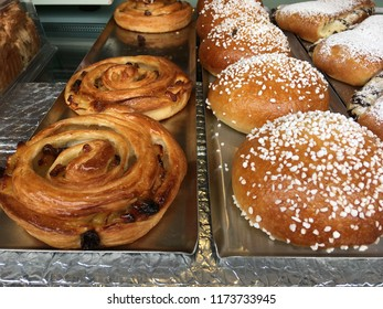 Fresh bread and buns on the counter of a bakery in Israel