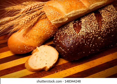 fresh bread with butter on top and wheat on the wooden