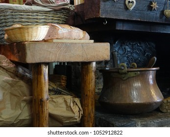 Fresh bread and cooking pots on old fashioned wood fireplace,  Avoriaz, France