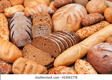 Fresh bread of different varieties rye and wheat .