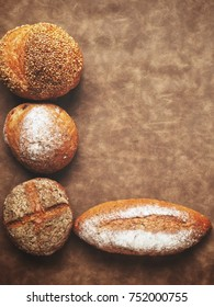 Fresh bread on brown background