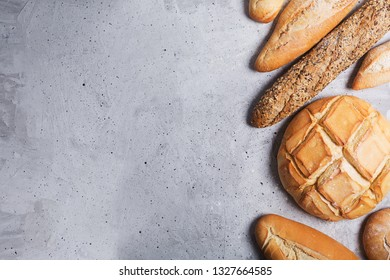 Fresh bread on concrete background. Top view with copy space, horizontal orientation
