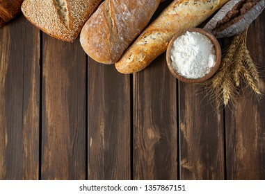 fresh bread on wooden surface
