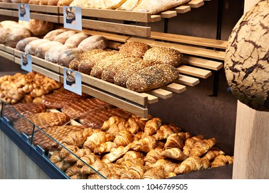 Fresh bread and pastries on shelves in a bakery