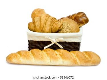 fresh bread rolls in a basket on whitete