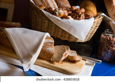 Fresh bread slice and cutting knife on table