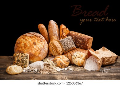 Fresh bread still life on wooden table
