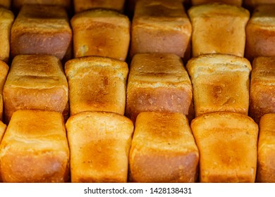 Fresh bread in supermarket. Loafs of bread. Bakehouse background.