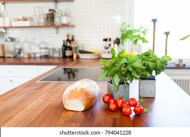 fresh bread, tomatoes and basil on the kitchen counter top