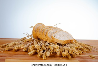 Fresh bread and wheat on the table