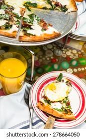 Fresh breakfast pizza with three farm fresh eggs in Italian restaurant.