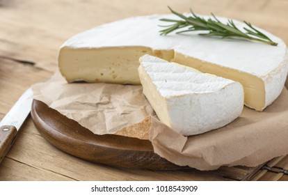 Fresh Brie cheese with herbs