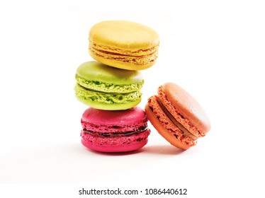 Fresh bright colored Macarons, or macaroons isolated on white background