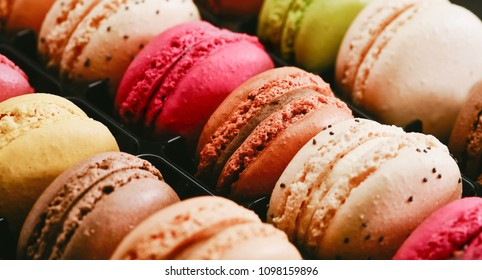 Fresh bright colored Macarons, or macaroons ready to eat at patisserie