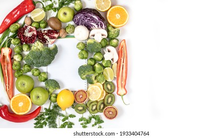 Fresh bright foods with notepad. A strategy for proper and healthy eating. Top view on grocery background