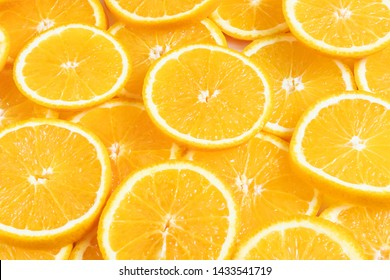 Fresh bright round orange slices. Shades of orange. Flat lay, top view, bright design. Fruit composition. Concept of vitamin C, healthy wholesome food.