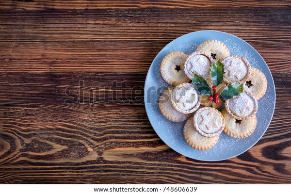 Fresh British Mince Pies for Christmas on a wooden surface