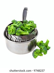 Fresh broccoli loaded into a steamer and saucepan, ready for steaming.