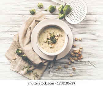 fresh broccoli soup with croutons and herbs