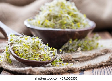 Fresh Broccoli Sprouts (detailed close-up shot) on vintage wooden background